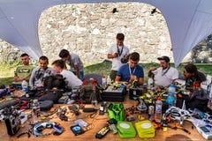 Eastern Europe Cup 2017 of drone racing in Uzhgorod, Ukraine. Uzhgorod, Ukraine - September 2, 2017: Competitors repair their drones in the repair area during Royalty Free Stock Photo