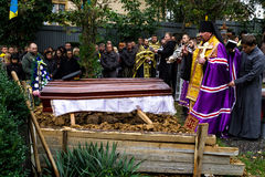 In Uzhhorod farewell to soldier who died of wounds in the ATO zone. Uzhhorod, Ukraine - 2016. October 12: The priest buries heroic deceased Ukrainian soldier on Stock Photo