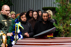 In Uzhhorod farewell to soldier who died of wounds in the ATO zone. Uzhhorod, Ukraine - 2016. October 12: Relatives and friends stand near the coffin of the Stock Image