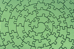 uzupełnia zieloną jigsaw Fotografia Stock