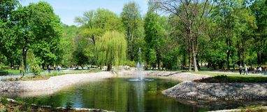 Uzupis park in Vilnius city on May. Lithuania. VILNIUS, LITHUANIA - MAY 1 : Uzupis park in Vilnius city on May 1, 2014, Vilnius, Lithuania Royalty Free Stock Images
