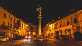 Uzupis in Vilnius. Uzupis angel statue in Vilnius at night Stock Photo