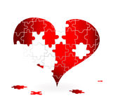 Uzzle with broken heart Stock Image