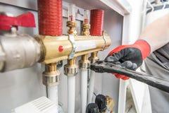 Válvulas de calefacción de la casa fotografía de archivo libre de regalías