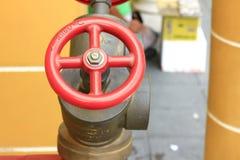 Válvulas rojas para los extintores Imagen de archivo libre de regalías