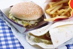 Vária comida lixo na tabela Fotos de Stock Royalty Free