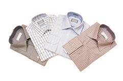 Várias camisas isoladas Fotografia de Stock Royalty Free