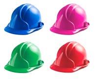 Várias cores dos capacetes de segurança imagem de stock