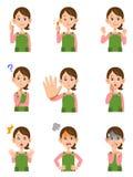 Várias expressões faciais de uma mulher com aventais ilustração stock
