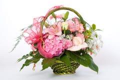 Várias flores na cesta Imagens de Stock Royalty Free