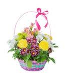 Várias flores na cesta Imagens de Stock