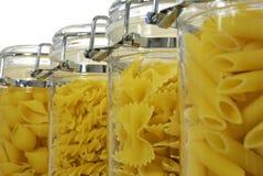 Várias formas da massa em uns frascos Fotos de Stock