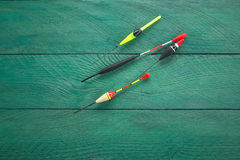 Vários flutuadores em uma superfície de madeira Fotografia de Stock Royalty Free