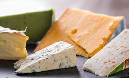 vários queijos em uma placa imagem de stock royalty free