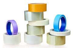 Vários rolos da fita adesiva no branco Imagens de Stock