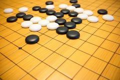 Vão o jogo ou o jogo de mesa do chinês de Weiqi Foto de Stock Royalty Free