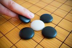 Vão o jogo ou o jogo de mesa do chinês de Weiqi Imagem de Stock Royalty Free