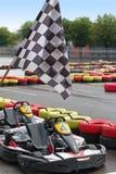 Vão os karts e a bandeira da raça Imagem de Stock Royalty Free