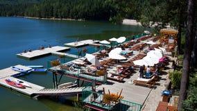 Văliug-Trei Ape I. Văliug lake and pontoon from resort with same name,Caras-Severin county,Romania Royalty Free Stock Images