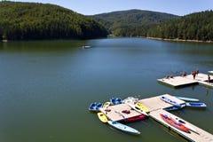 Văliug-Trei Ape II. Văliug lake and pontoon from resort with same name,Caras-Severin county,Romania Stock Photography