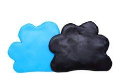 Väder för det svarta molnet förutser lera för symbolssymbolplasticine Arkivbilder