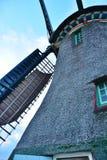 Väderkvarnnärbild mot blå himmel Fotografering för Bildbyråer