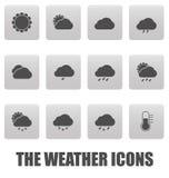 Vädersymboler på gråa fyrkanter Arkivfoto