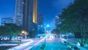 Väg för huvudväg för arkitektur för storartad stadig för tidschackningsperiod för neon för blått för natt för ljus trafik för bel arkivfilmer