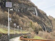 Väg i Trentino med den photovoltaic växten royaltyfria foton
