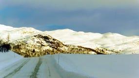 Väg med is och snö Royaltyfri Fotografi