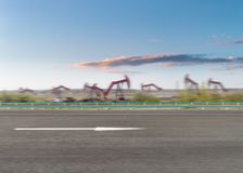 Väg och olja som pumpar maskinbakgrund royaltyfria foton