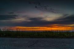 Väg på solnedgången Arkivbild