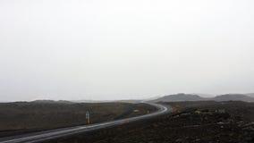 Väg till och med Island under dåligt väder Royaltyfri Foto