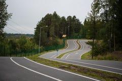 Vägen i en gräsplan parkerar Fotografering för Bildbyråer