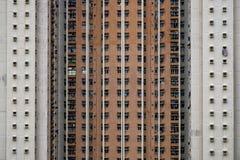 Vägg av hyreshusbakgrund arkivbild