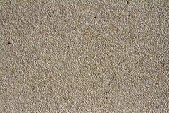 Vägg av liten stentextur Kiselstenar och sandväggtextur Liten bakgrund för stenvägg för design med kopieringsutrymme Fotografering för Bildbyråer