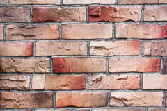 Vägg av röd och brun tegelstentextur Fotografering för Bildbyråer
