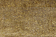 Vägg av små guld- plattor Fotografering för Bildbyråer