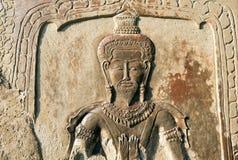 Vägg av templet som dekoreras med lättnader Arkivfoto