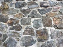 Vägg av texturen av den naturliga stenen Royaltyfria Bilder