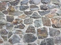 Vägg av texturen av den naturliga stenen Royaltyfria Foton