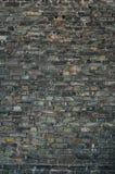vägg för bakgrundstegelstendark royaltyfri fotografi