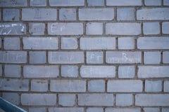 vägg för bakgrundstegelstengrey arkivbilder