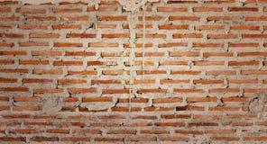 vägg för bakgrundstegelstentextur Gammal tappningtegelstenvägg arkivfoton