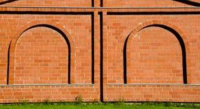 vägg för efterföljd för ärke- bakgrundstegelsten dekorativ Royaltyfri Bild