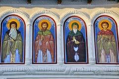 vägg för fyra målande religiös saints royaltyfri bild
