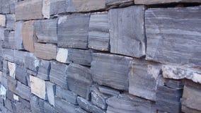 Vägg för granitstentegelsten Arkivbild