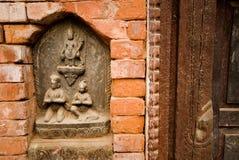 vägg för gudnepal sten temple1 Arkivfoto