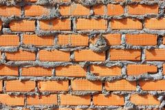 Vägg för röd tegelsten, apelsin Royaltyfri Bild