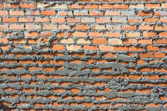 Vägg för röd tegelsten, apelsin Royaltyfri Foto